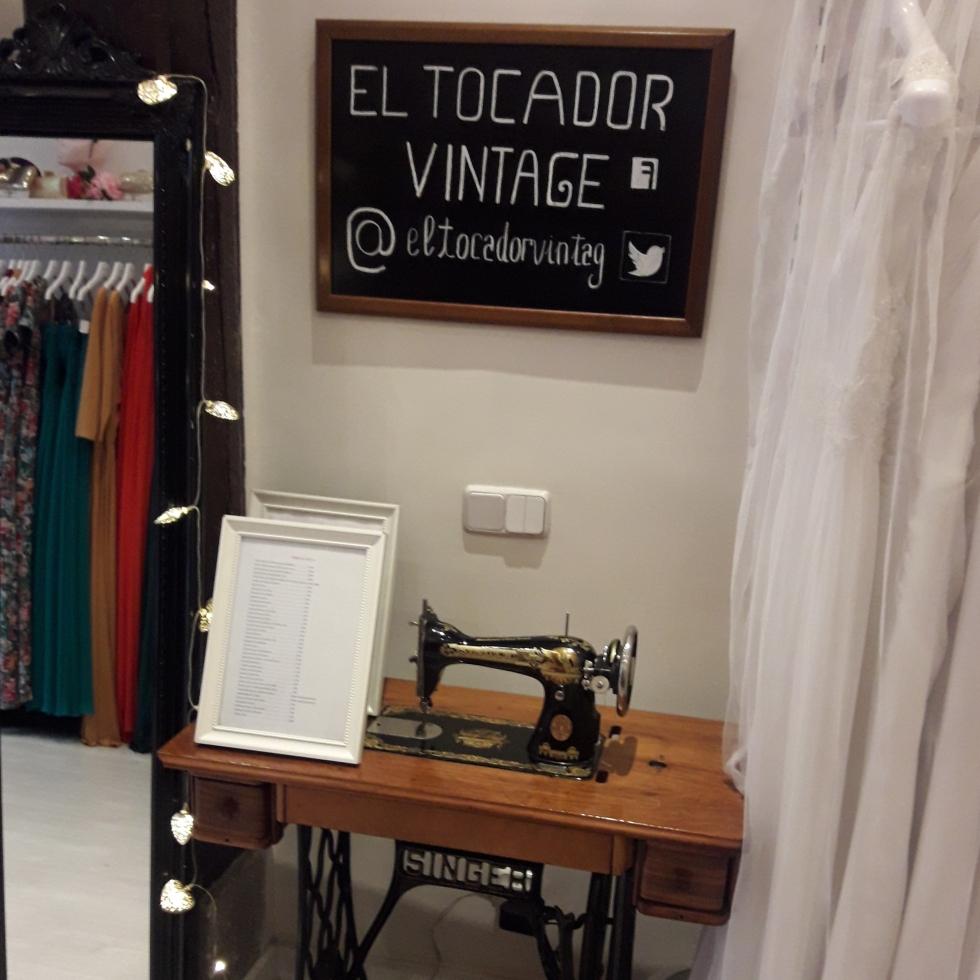 "Sign reading ""El Tocador Vintage"" greets you as you enter the shop."