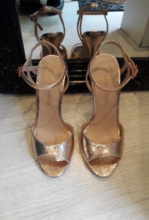 Pair of golden, open-toed, strappy heels